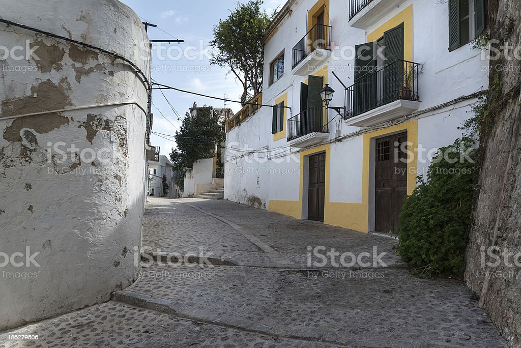Typical Mediterranean alley between old houses royalty-free stock photo