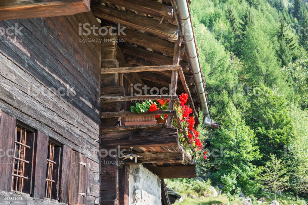 Typical mountain house with flowered balcony, European Alps stock photo
