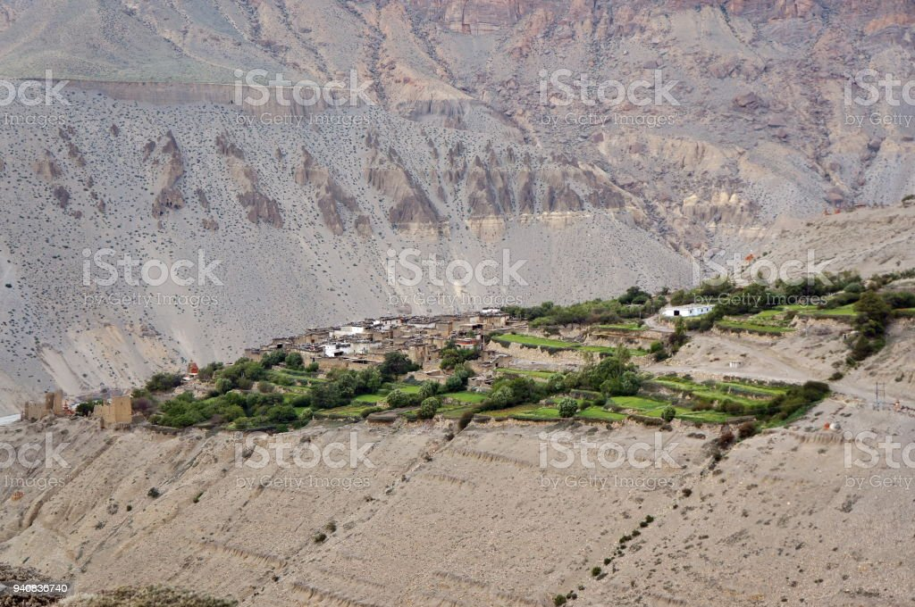Typical Mustang village Tangbe (3040 m) against the background of the mountain. stock photo
