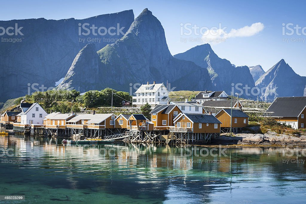 Typical Norwegian fishing village with traditional red rorbu hut stock photo