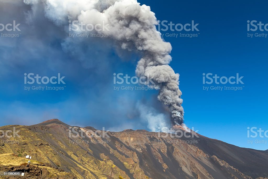 typical of volcanic ash plume shaped by the wind stock photo