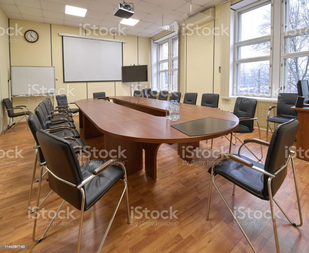 Typical Office Meeting Room Long Table And Chairs Stock Photo - Download  Image Now