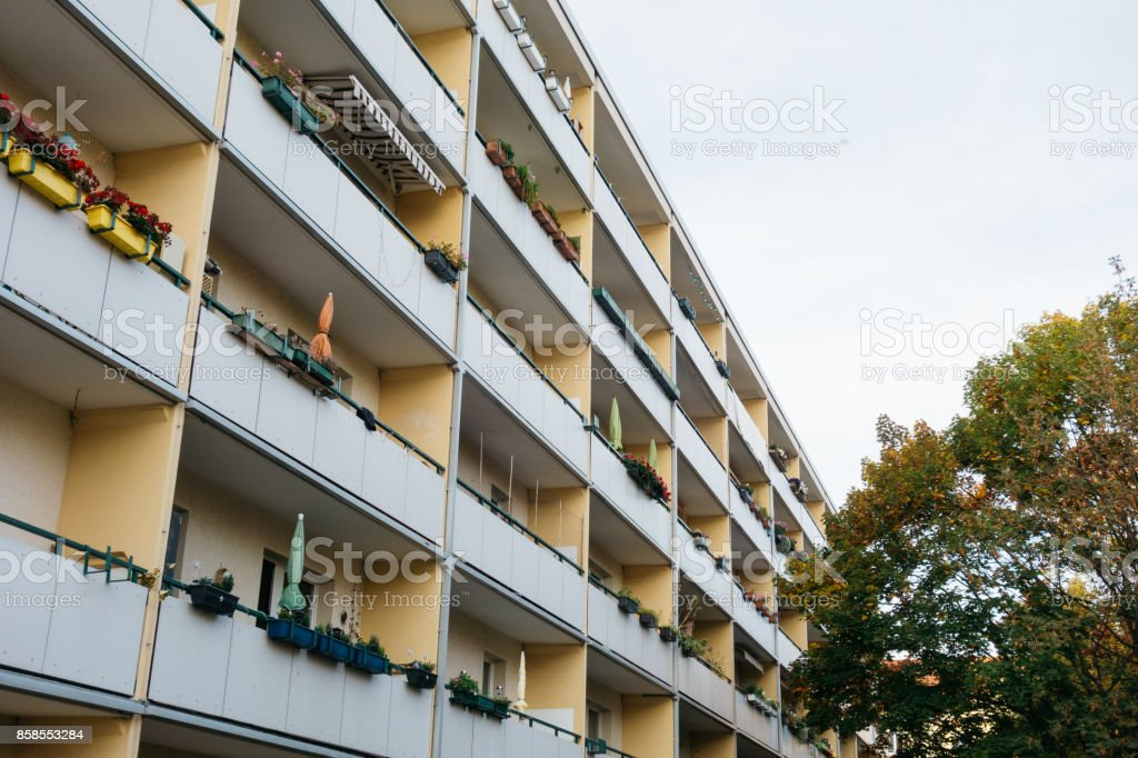 typical plattenbau apartment building with big balcony stock photo