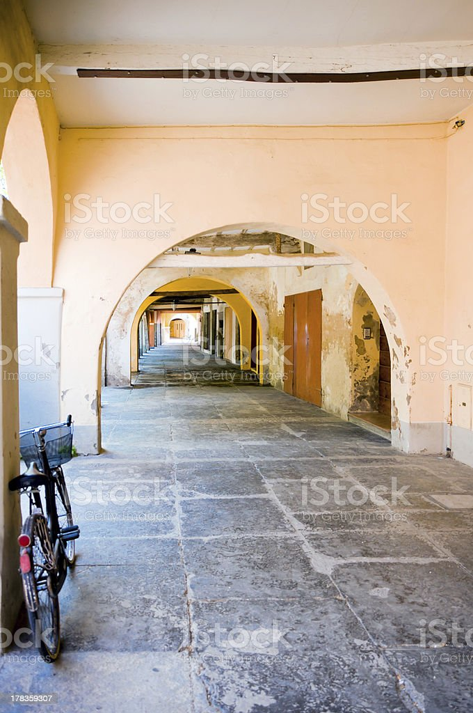 Typical porch with bicycle in Novellara, Italy royalty-free stock photo