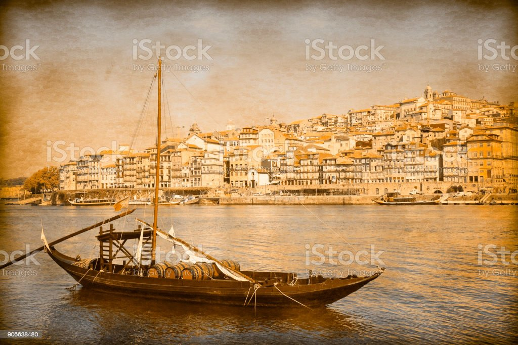 Typical portuguese boats used in the past to transport the famous port wine- Vintage and Retro Photo Effects added stock photo