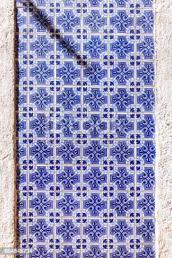 istock Typical Portuguese old ceramic wall tiles (Azulejos) 664848734