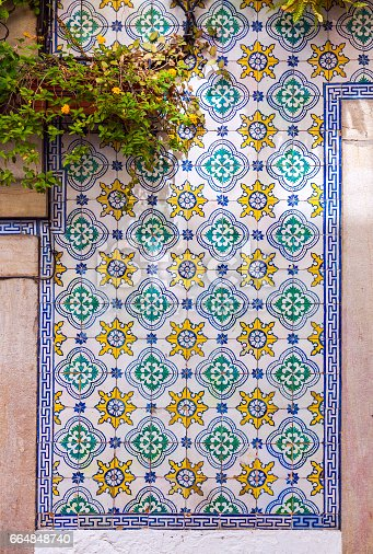 istock Typical Portuguese old ceramic wall tiles (Azulejos) 664848740