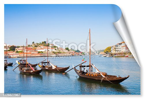 Typical portuguese wooden boats, called barcos rabelos, used in the past to transport the famous port wine (Porto-Oporto-Portugal-Europe) - concept image