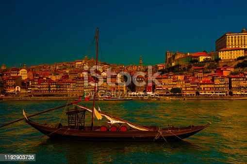 Typical portuguese wooden boats, called barcos rabelos, used in the past to transport the famous port wine (Porto-Oporto-Portugal-Europe) - dusk toned image.