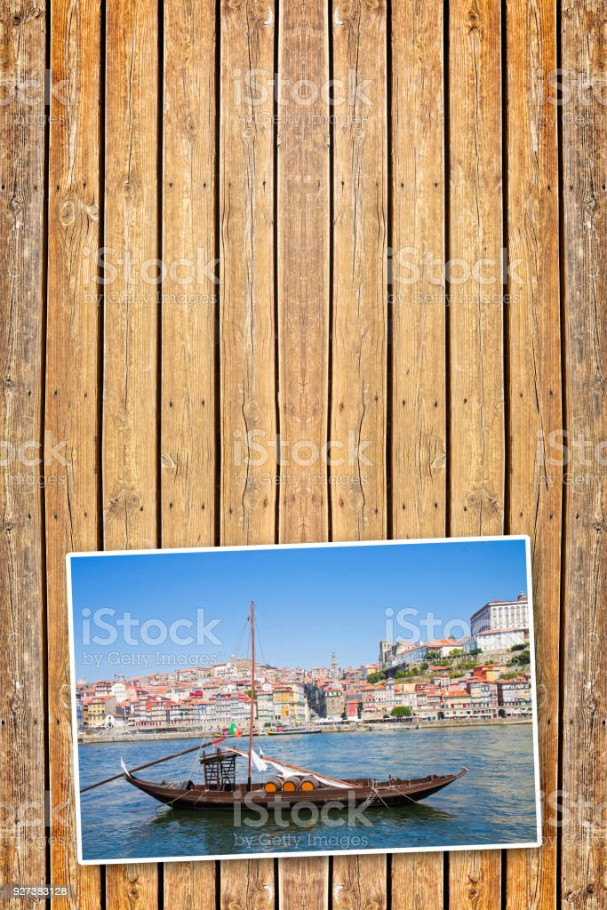 Typical portuguese wooden boats, called -barcos rabelos-, used in the past to transport the famous port wine (Porto - Oporto - Portugal - Europe) - Concept image with copy space on wooden background stock photo