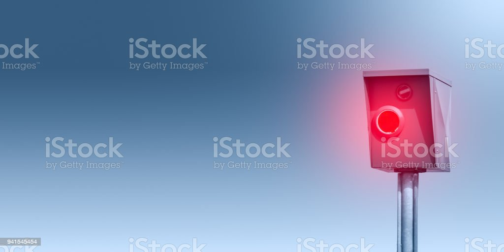 A typical radar trap, speed trap, speed camera in front of blue background - Banner - foto stock