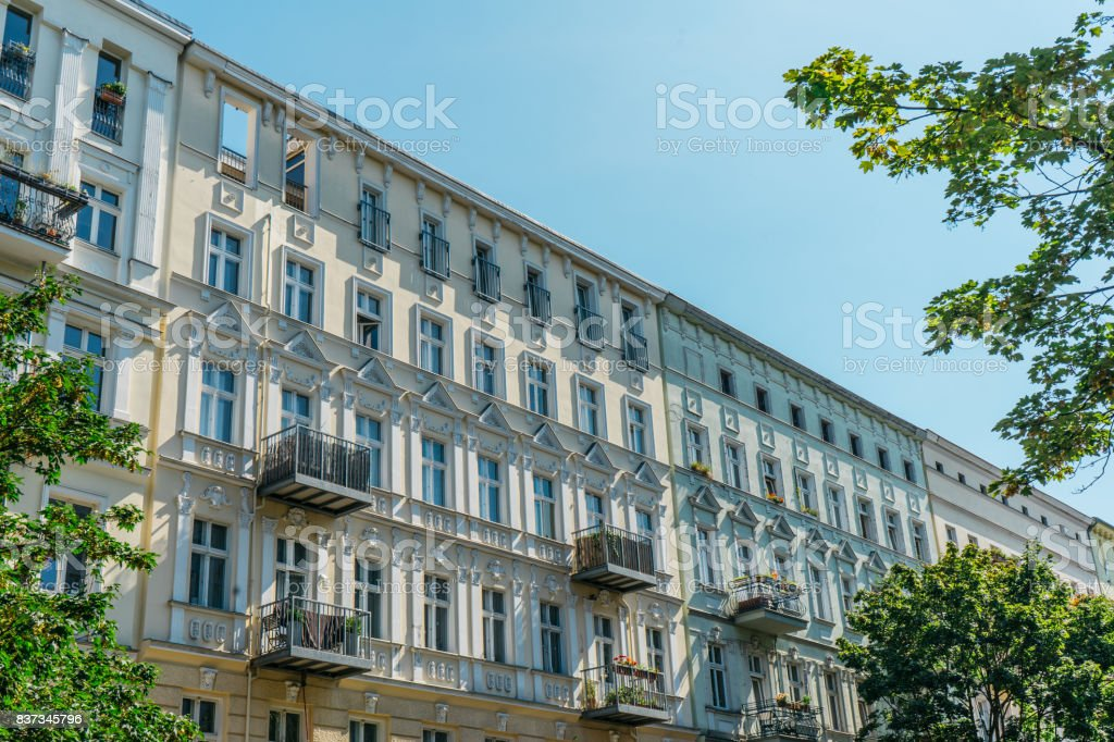 typical real estate picture of luxury row apartment buildings at berlin stock photo