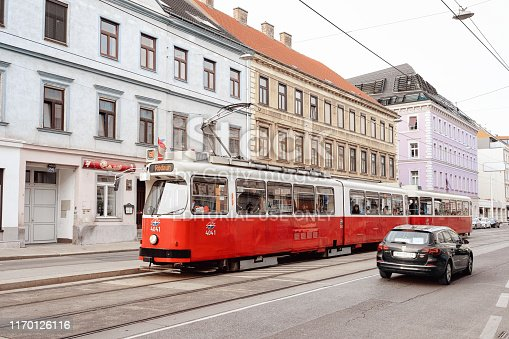 Vienna, Austria - May 8, 2019: Typical red tram Rodaun 60 on road in Mariahilfer Strasse in Innere Stadt in Old city center, Vienna, Austria. Public transport and Street archtecture in Wien in Europe