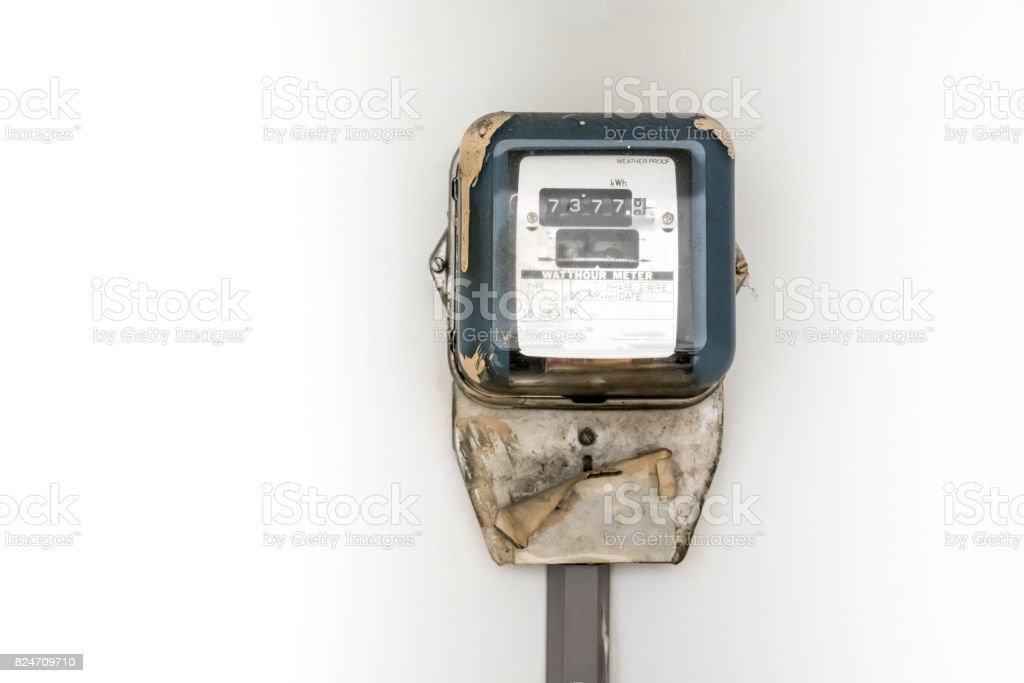 Typical residential analog electric meter with transparent plastic case stock photo