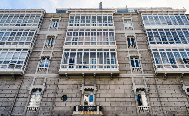 Typical residential building facade in La Coruna, Spain; low angle view - foto stock