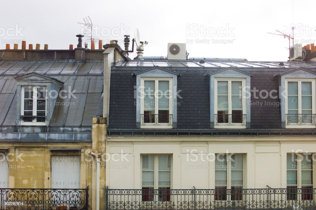 Typical roofs and facades details of buildings in Paris, France stock photo