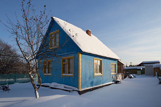 Typical Russian dacha in winter Moscow Oblast Region, Russia - January 06, 2016: While cold weather stays at Moscow region anyone can safely take a look over the fence at typical Russian dacha russian dacha stock pictures, royalty-free photos & images