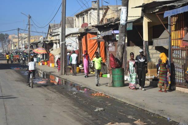 typical scene on the street in saint louis, senegal - st louis стоковые фото и изображения