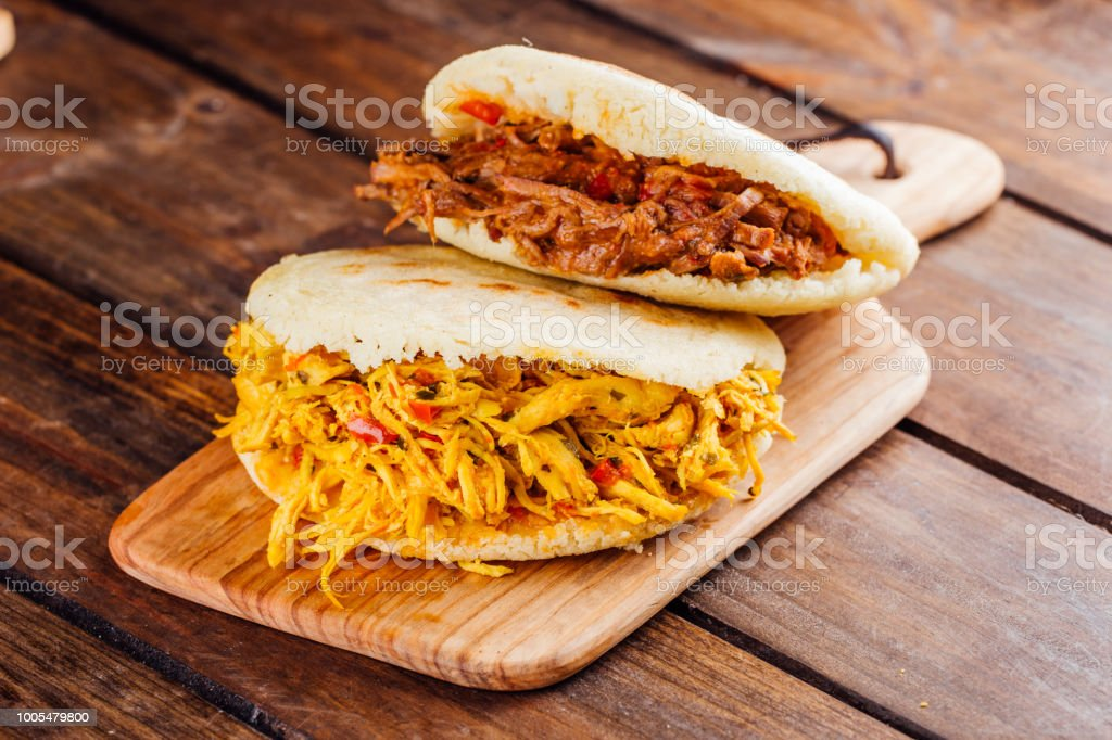 Typical South American breakfast, arepa with chicken and roasted meat stock photo