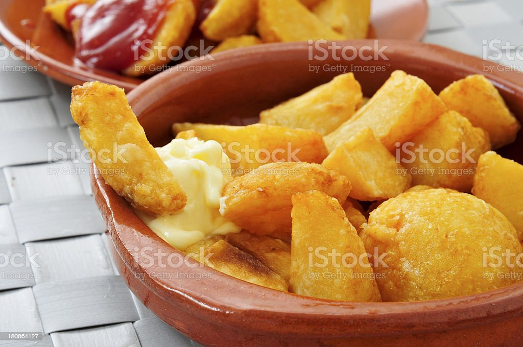 typical spanish patatas bravas, fried potatoes with a hot sauce stock photo