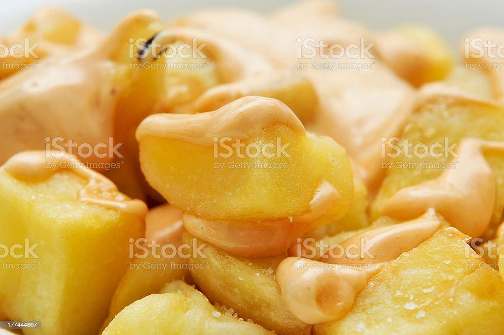 typical spanish patatas bravas, spicy potatoes stock photo