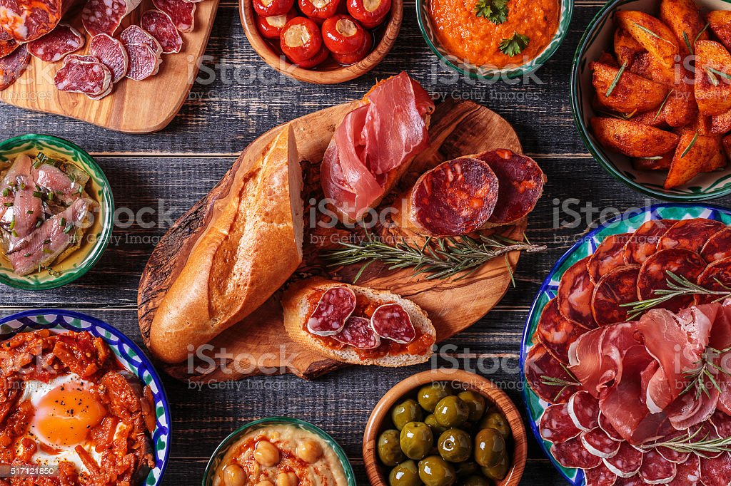 Typical spanish tapas concept, rustic style,  top view. stock photo