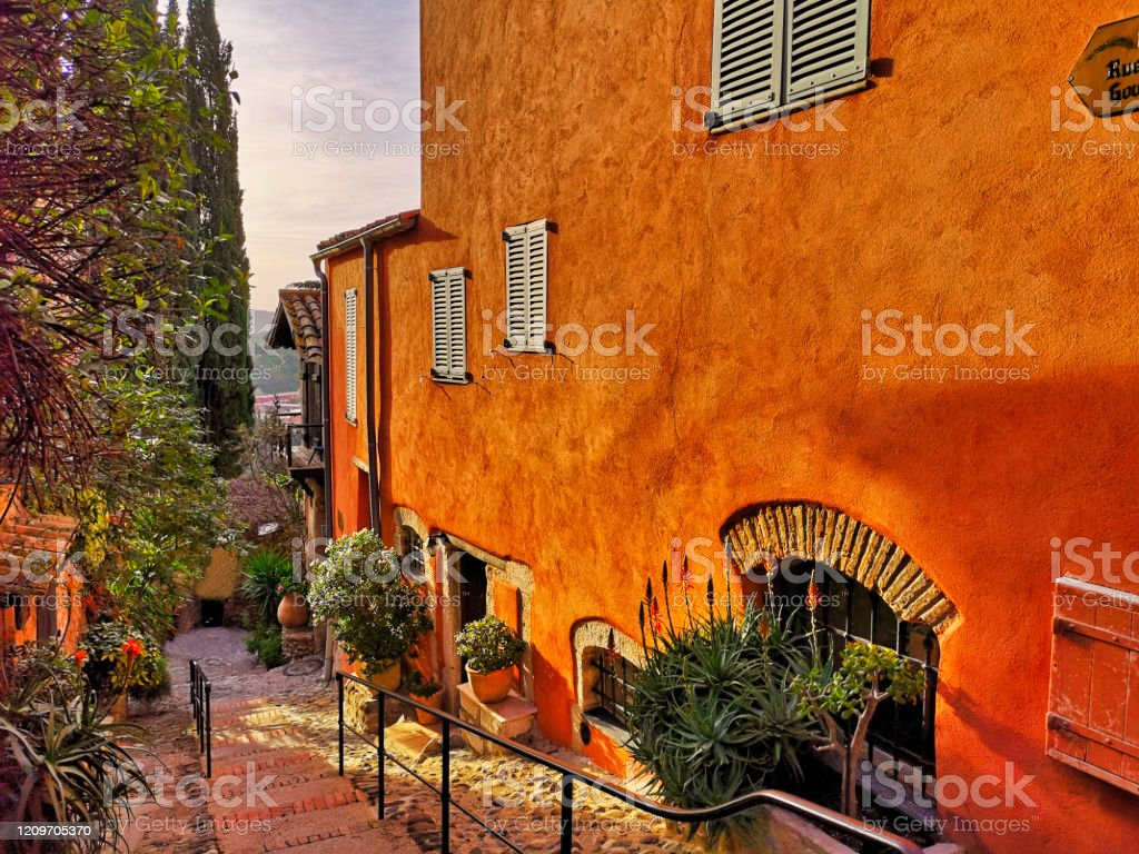 Typical street in a provencal village, south of France on the french Riviera - Royalty-free Alley Stock Photo