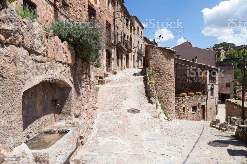 Typical street in Mura, Catalonia, Spain. stock photo
