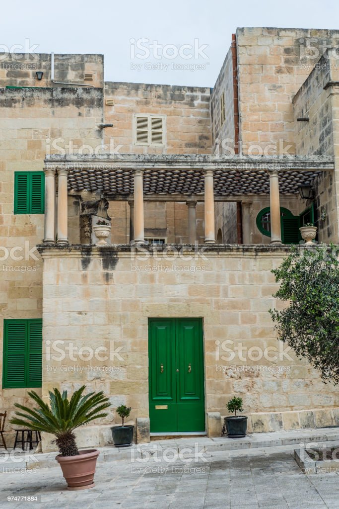 Typical street of Malta, ancient buildings and architecture stock photo