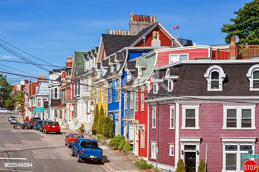 Stock photograph of typical street with colorful clapboard townhouses in St John's, Newfoundland, Canada