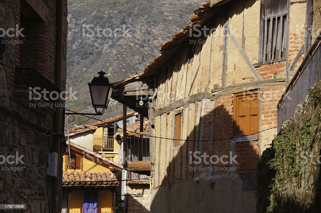 Typical street with houses of wood, adobe, brick and stone royalty-free stock photo