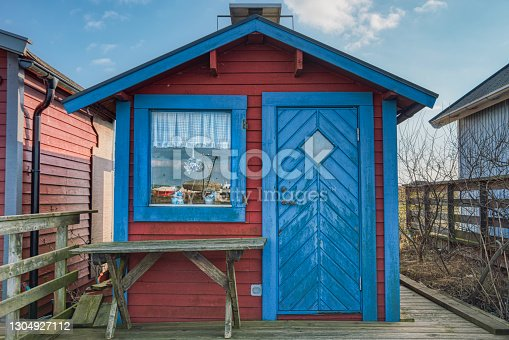 istock A typical Swedish summerhouse. The wooden facade and coarse table on the porch suggest a minimalism and a rustic minimal lifestyle 1304927112