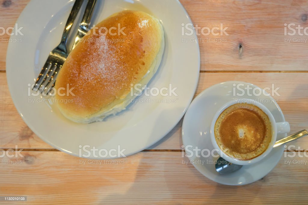 Typical sweet and dessert of Bilbao called butter bun next to a cup of espresso coffee. Basque Country - foto stock