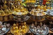 Typical tea sets with teapots and tea glasses for sale on sale at at Istanbul Spice Bazaar (Egyptian Bazaar), Turkey