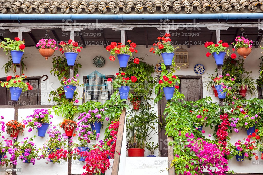 Typical Terrace (balcony) decorated Pink and Red Flowers, Spain stock photo