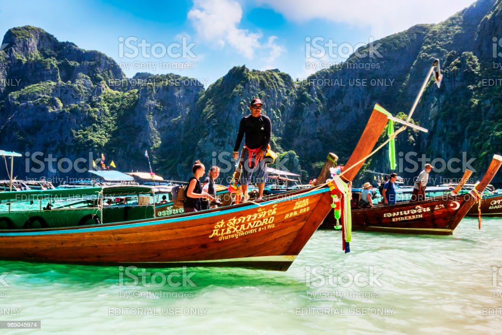 Typical Thai vessel used for tourists transport, moored on Ko Phi Phi Lee island  beach zbiór zdjęć royalty-free