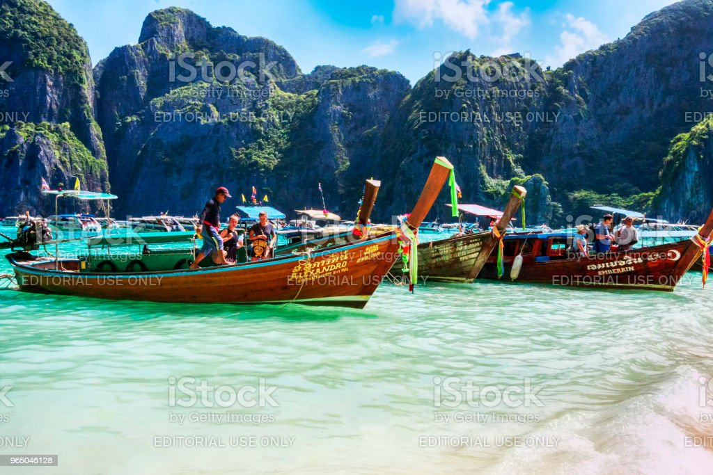 Typical Thai vessels used for tourists transport, moored on Ko Phi Phi Lee island  beach royalty-free stock photo