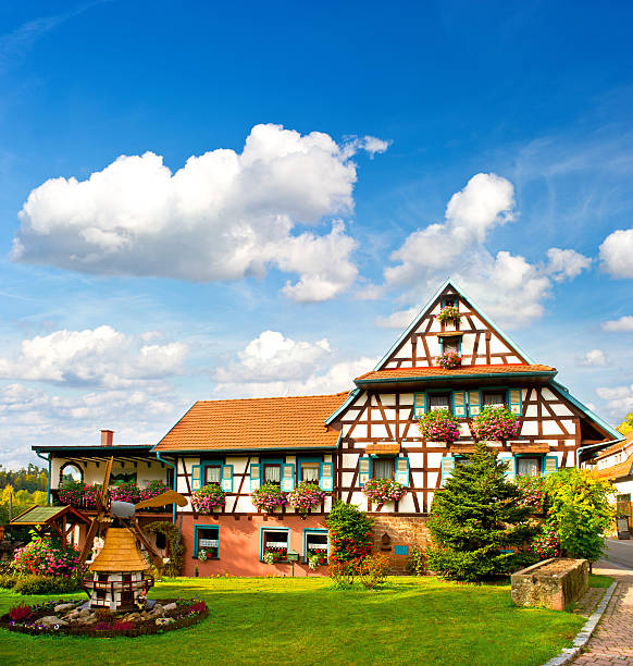 typical traditional house in the Black Forest, Germany typical traditional house in the Black Forest, Southern Germany. european landscape with flowers garden and cloudy blue sky half timbered stock pictures, royalty-free photos & images