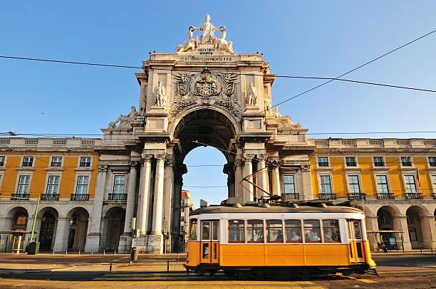 typical tram in commerce square, lisbon, portugal - spårvagn bildbanksfoton och bilder