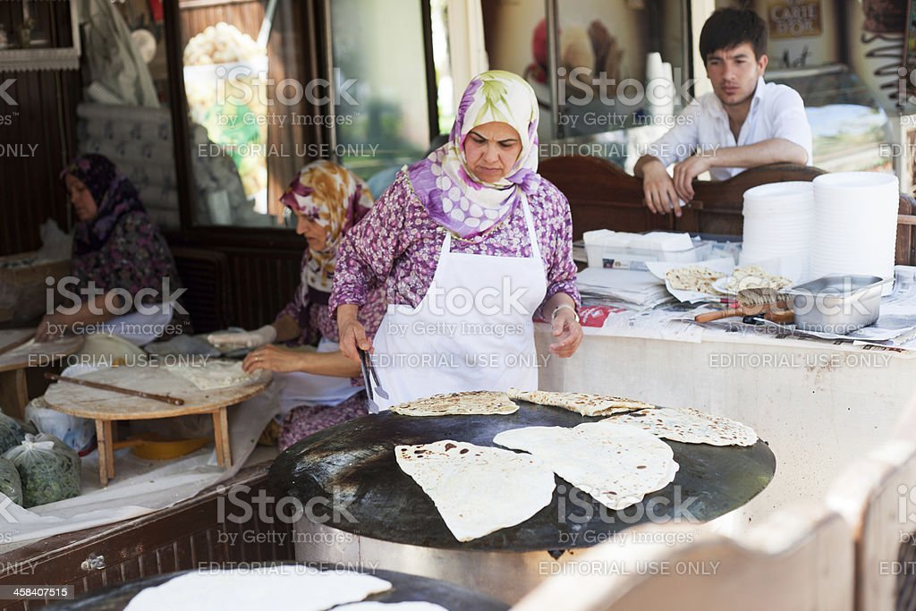 Typical Turkish flat bread with melted cheese on top stock photo
