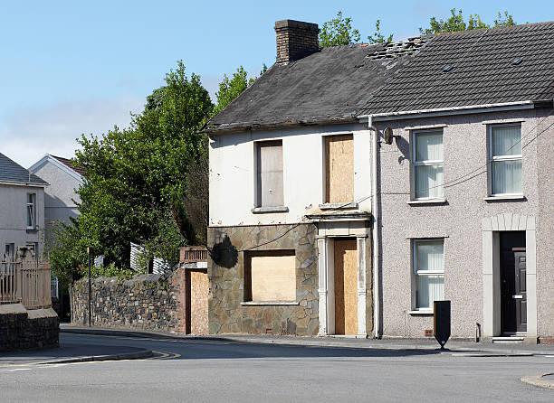 Typical UK terraced housing street derelict stock photo