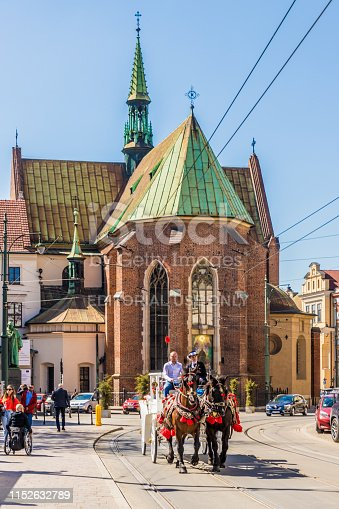 Krakow Poland. April 2019. A view of a horse drawn carriage riding through the medieval old town in Krakow. The horse drawn carriage rides through the medieval old town are one of Krakow's top attractions among tourists.