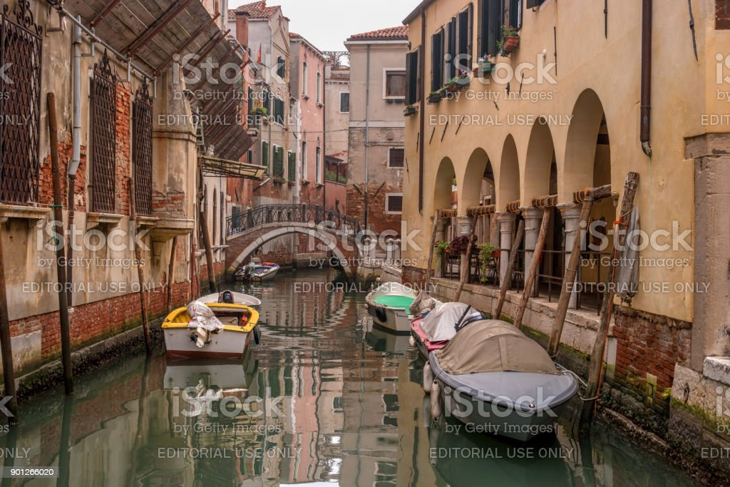 Typical view of the narrow side of the canal, Venice, Italy. Communication in the city is done by water, which creates a network of 150 channels interconnected. Nobody here. stock photo