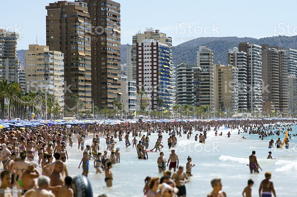Typical views of the beach in Benidorm holiday season. stock photo