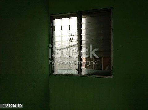 Typical window with shutters and balcony in dark interior ideal for adding text. background concept