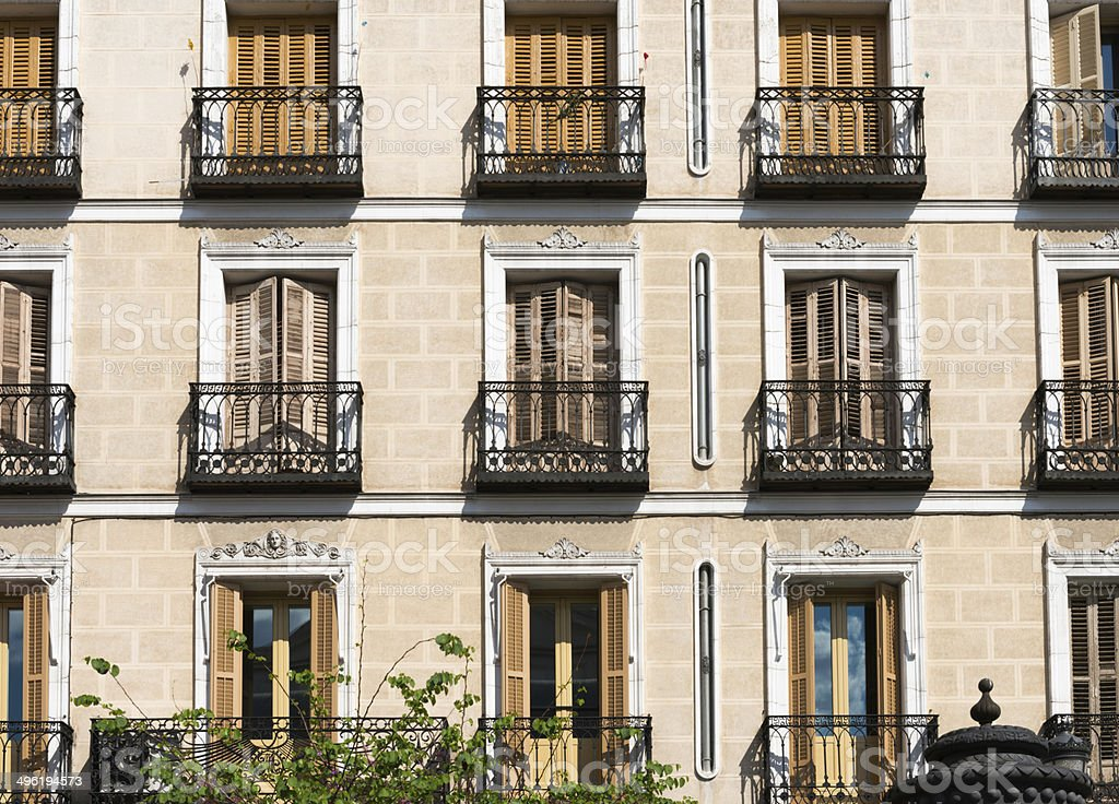 Typical windows and balconies in a house in Madrid stock photo