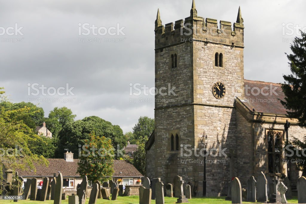 Typically british church and church yard in rural Britain stock photo