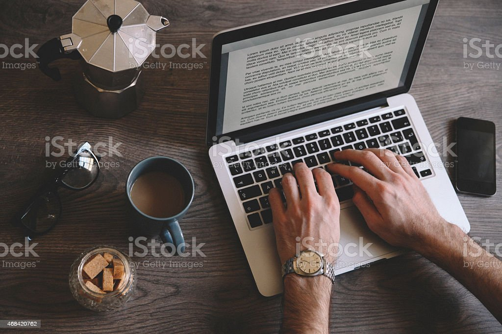 typing a novel on the computer stock photo