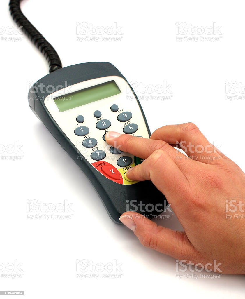Typing a pin number stock photo