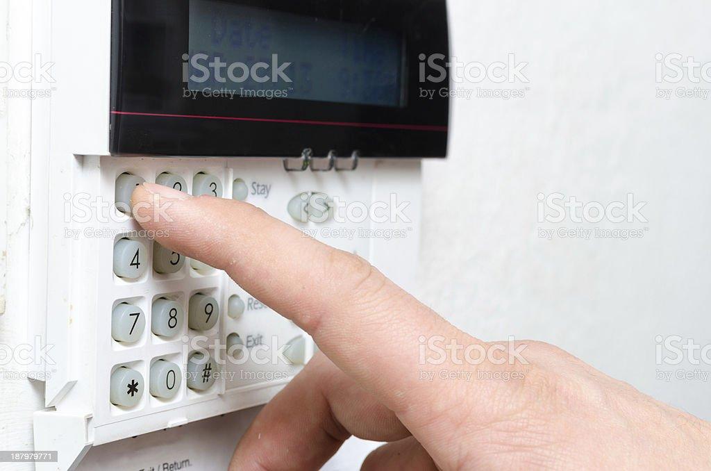 Typing alarm code stock photo